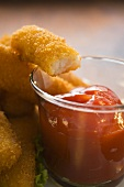 Fish finger with ketchup (a bite taken)