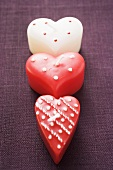 Three heart-shaped candles for Valentine's Day