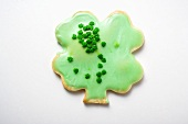 Shamrock biscuit with green icing for St. Patrick's Day