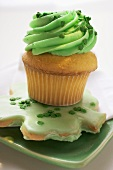 Muffin with green cream & shamrock biscuit for St. Patricks Day