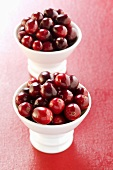 Cranberries in two small bowls