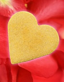 Shortbread cookie on rose petals for Valentine's Day