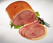 A piece of cooked ham and three slices