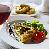 A piece of courgette frittata with salad garnish