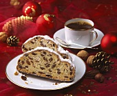 Two slices of stollen and cup of coffee; Christmas decoration