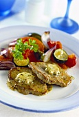 Pork steaks with herb butter and vegetable accompaniments