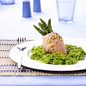 Steamed salmon trout with green asparagus and pea puree