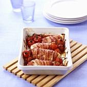 Bacon-wrapped chicken roulades with cheese filling