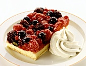 A piece of berry cake with cream