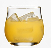 Orange juice with ice cubes in glass