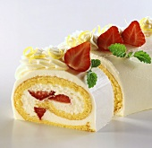 Sponge roulade with lemon cream and strawberries
