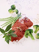 Beef sirloin with vegetables and ice cubes