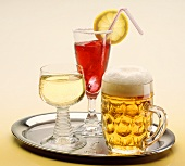 Tray with light beer, white wine and cocktail