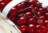 Red cherries in a chip basket, close-up