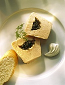 Sliced smoked Salmon Terrine with Caviar center and Bread slice