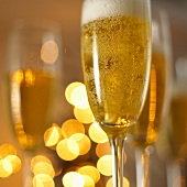 A glass of champagne in festive light