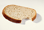 A slice of bread with a bite taken