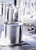 Tinned milk, milk jug in background