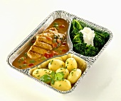 Grilled pork steak in pepper sauce in aluminium container