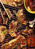 Grill rack with lamb cutlets and T-bone steaks