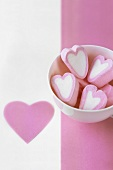Several pink and white marshmallow hearts