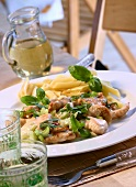 Strips of turkey with celery and penne