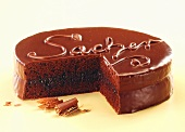 Sacher torte with the word 'Sacher', a piece cut