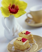 Two petit fours with an orchid in the background