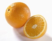One half and one whole orange