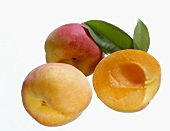 One half and two whole peaches