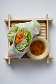 Vietnamese rice paper rolls with vegetables and dip