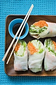 Rice paper rolls with soy dip and chopsticks
