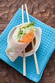 Vietnamese rice paper rolls with chopsticks and dip