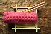 Asian table accessories: hand towel, chopsticks, bamboo mat
