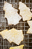 Fir tree shaped biscuits sprinkled with icing sugar