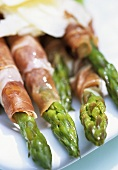 Green asparagus wrapped in ham