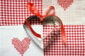 Heart-shaped biscuits with red gift ribbon