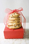 Biscuits tied with red bow on gift box
