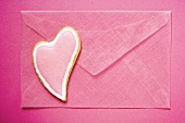 Pink envelope with heart-shaped biscuit