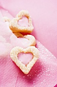 Pink envelope with heart-shaped biscuits (detail)