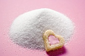 Heart-shaped biscuit on granulated sugar