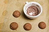Unbaked hazelnut biscuits, cocoa and sugar mixture