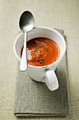 Red pepper cream soup in soup cup