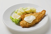 Fish fillet with mayonnaise and potato salad
