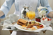 Chambermaid carrying breakfast tray