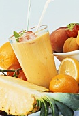 Pineapple and orange juice with fresh fruit