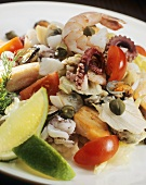 Seafood salad with lime wedges