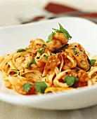 Noodles with seafood and tomato sauce