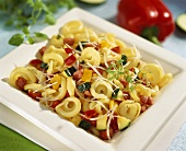 Tortellini with vegetables and diced bacon
