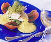 Fish fillet with vegetables, herbs and wine froth